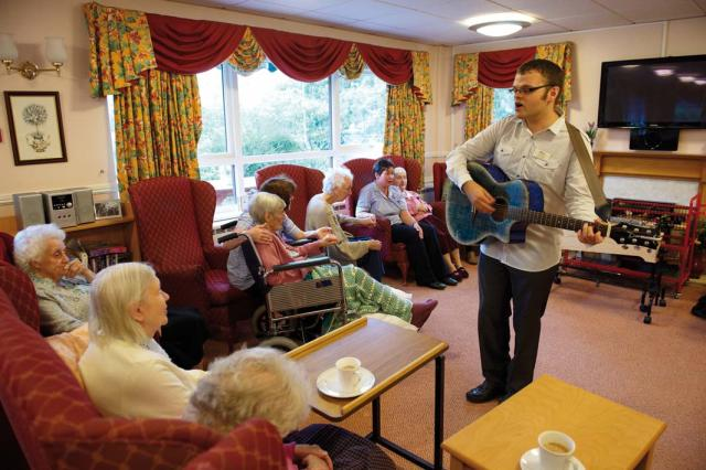Chris Wilson takes a group music therapy session