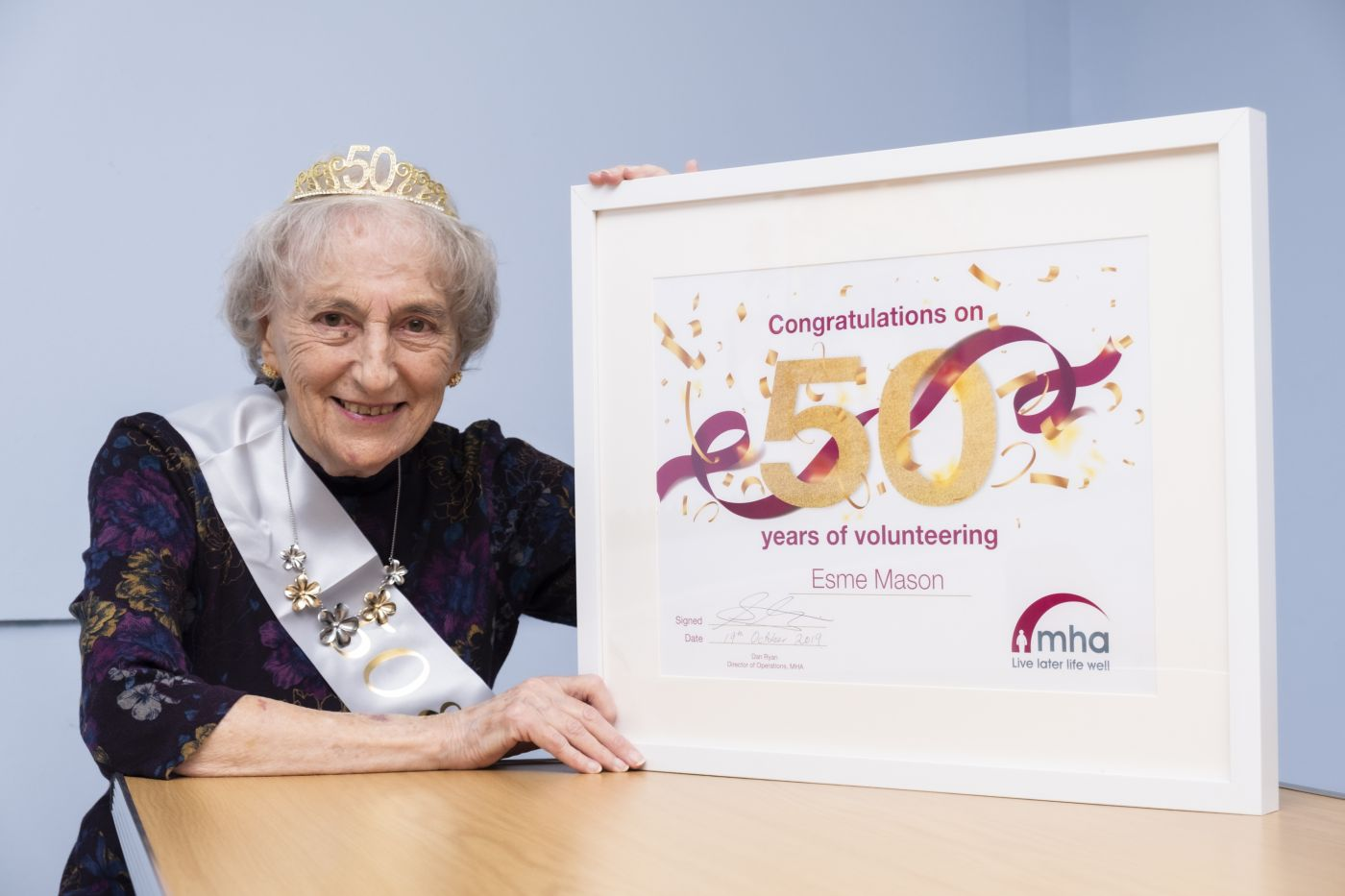 Esme Mason with her 50 year volunteering certificate